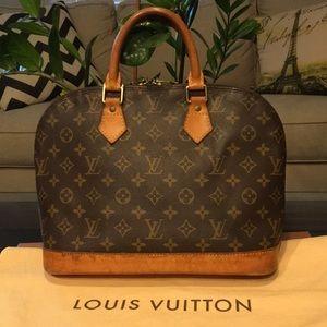 Authentic Louis Vuitton Alma w Dust bag